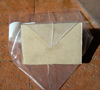 Tape corner to cardboard